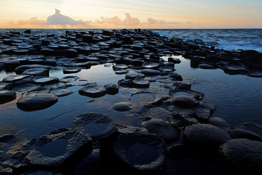 Partially submerged basalt columns at Giant's Causeway near sunset, County Antrim, Northern Ireland, United Kingdom