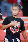17 October 2004: A DC United fan during the playing of the national anthem. DC United defeated the MetroStars 3-2 at RFK Stadium in Washington, DC during a regular season Major League Soccer game..