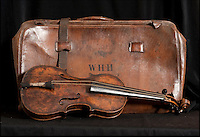 BNPS.co.uk (01202 558833)<br /> Pic: Phil Yeomans/BNPS<br /> <br /> And the band played on...<br /> <br /> Poignant reminder - Wallace Hartley's Violin case found strapped to his body after the sinking.<br /> <br /> The violin played by the bandmaster on the Titanic as the ship was sinking is finally being auctioned for an estimated &pound;400,000.<br /> <br /> The wooden instrument has been proven to be the one used by Wallace Hartley as his band famously played on to help keep the passengers calm during the disaster.<br /> <br /> Its existence and survival only emerged in 2006 when the son of an amateur violinist who was gifted it by her music teacher in the early 1940s contacted an auctioneers.