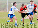 Sneem/Derrynane Ian Galvin in possession of the ball closely watched by Annascaul David Clifford and John Bowler during the Junior Premier Championship Qualifier match at the Paddy Kennedy Memorial Park, Annascaul, on Sunday afternoon.
