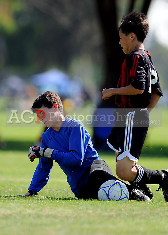 The U-13 De Anza Titans 96 Vs SCA 97 B during the BUSC Summer Classic in Pleasanton, California August 16, 2009. (Photo by Alan Greth)