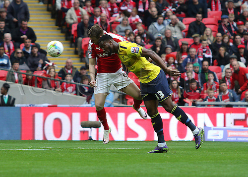 03.04.2016. Wembley Stadium,  London, England. Johnstones Paint Trophy Football Final Barnsley versus  Oxford Utd. Barnsley's Sam Winnall challenges for header and it goes in off Dunkley (Oxford) for the own goal 1-1