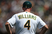 OAKLAND, CA - JULY 22:  Third base coach Matt Williams #4 of the Oakland Athletics stands on the field during the game against the San Francisco Giants at the Oakland Coliseum on Sunday, July 22, 2018 in Oakland, California. (Photo by Brad Mangin)
