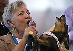 Ruth Hagan and Gus sing the National Anthem at the Wiener Dog Races at the Reno Rodeo in Reno, Nev., on Saturday, June 28, 2014.<br /> Photo by Cathleen Allison