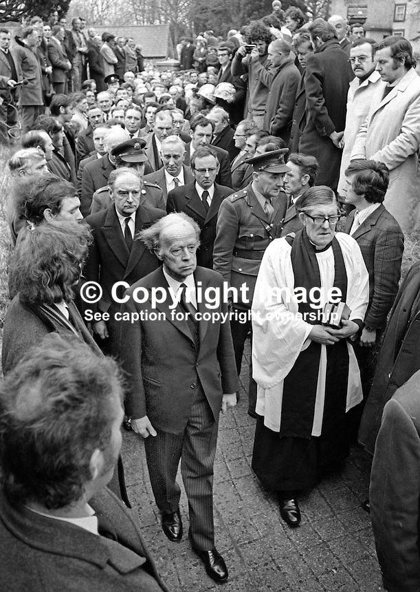 Erskine Childers, the Irish President, left joined the mourners at the funeral of Senator Billy Fox, 35 years, Protestant, Fine Gael politician, Co Monaghan, Rep of Ireland, 14th March 1974. Immediately behind Childers is the Irish prime minister, An Taoiseach, Liam Cosgrave. Fox was previously a TD (Irish MP).  He was visiting the home near Clones of his fiancee which unknown to him had been taken over by thirteen armed paramilitaries. He ran from the scene but was followed and shot dead in a nearby field. Five members of the Provisional IRA were subsequently tried and convicted of the killing. Alongside Childers is Rev T J Gray, the local Church of Ireland minister. 197403140164a<br />