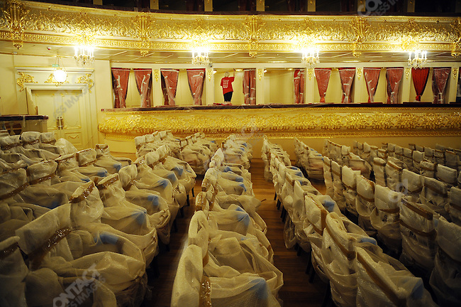 A worker in The Bolshoi Theatre puts final touches to the paint in one of the boxes as the seat are covered in protective plastic. The Bolshoi has been undergoing major renovations since 2005 and is set to reopen on October 28, 2011. Moscow, Russia, July 22, 2011