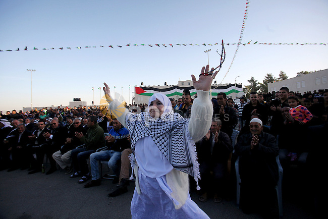 A Palestinian women dances in a mass wedding ceremony for 27 couples, supported by Palestinian President Mahmoud Abbas in the West Bank city of Jenin November 24, 2016. Photo by Nedal Eshtayah