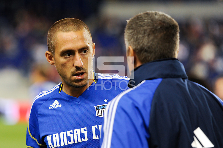 Davy Arnaud (22) of the Kansas City Wizards talks with head coach Peter Vermes. The New York Red Bulls defeated the Kansas City Wizards 1-0 during a Major League Soccer (MLS) match at Red Bull Arena in Harrison, NJ, on October 02, 2010.