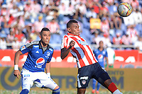 BARRANQUIILLA -COLOMBIA-22-03-2015. William Tesillo (Der) del Atlético Junior disputa el balón con Fernando Uribe (Izq) jugador de Millonarios durante partido por la fecha 11 de la Liga Águila I 2015 jugado en el estadio Metropolitano Roberto Meléndez de la ciudad de Barranquilla./ William Tesillo (R) player of Atletico Junior struggles the ball with Fernando Uribe (L) player of Millonarios during match for the 11th  date of the Aguila League I 2015 played at Metropolitano Roberto Melendez stadium in Barranquilla city.  Photo: VizzorImage/ Alfonso Cervantes / Cont