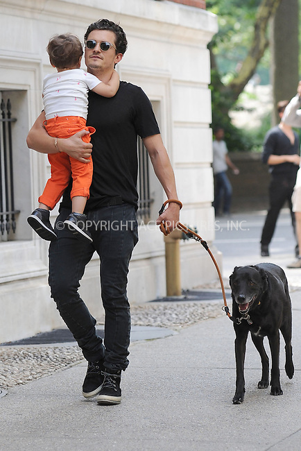 WWW.ACEPIXS.COM<br /> July 7, 2013 New York City<br /> <br /> Orlando and Flynn Bloom take their dog, Sidi, for a walk in Central Park in New York City on July 7, 2013.<br /> <br /> By Line: Kristin Callahan/ACE Pictures<br /> ACE Pictures, Inc.<br /> tel: 646 769 0430<br /> Email: info@acepixs.com<br /> www.acepixs.com<br /> Copyright:<br /> Kristin Callahan/ACE Pictures