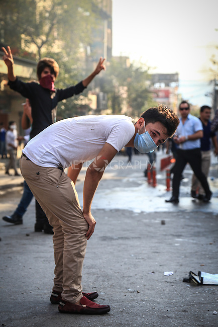 10/10/2015--Sulaimaniyah,Iraq-- A protestor is resting after throwing many rocks and inhaling tear gases.