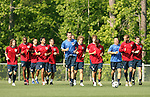 Pierre Barrieu (center, in blue), team trainer, leads the team on a jog around the field on Wednesday, May 17th, 2006 at SAS Soccer Park in Cary, North Carolina. The United States Men's National Soccer Team held a training session as part of their preparations for the upcoming 2006 FIFA World Cup Finals being held in Germany.