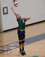 Marquette freshman Reilly Keevan serves the ball during the junior varsity volleyball match versus Vianney, which Marquette won in two sets, Monday, March 31, 2014 at Marquette High School, Clarkson Valley, MO.