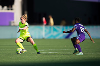 Orlando, Florida - Sunday, May 8, 2016: Seattle Reign FC midfielder Kim Little (8) turns away from Orlando Pride forward Jasmyne Spencer (23) during a National Women's Soccer League match between Orlando Pride and Seattle Reign FC at Camping World Stadium.
