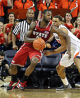 North Carolina State forward C.J. Leslie (5) drives past Virginia guard Justin Anderson (23) during the game Saturday in Charlottesville, VA. Virginia defeated NC State 58-55.