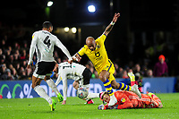 Andre Ayew of Swansea City goes down after a challenge from Marek Rodák of Fulham during the Sky Bet Championship match between Fulham and Swansea City at Craven Cottage on February 26, 2020 in London, England. (Photo by Athena Pictures/Getty Images)