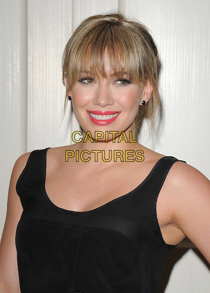 HILARY DUFF.at The The Beauty Detox Solution by Kimberly Snyder held at The London in West Hollywood, California, USA, .April 13th 2011..portrait headshot fringe  red lipstick make-up beauty black vest sleeveless  smiling .CAP/RKE/DVS.©DVS/RockinExposures/Capital Pictures.