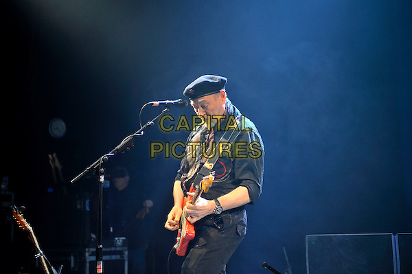 Richard Thompson.performing in concert, Shepherd's Bush Empire, London, England. .25th February 2013.on stage lie gig performance music side profile half length hat flat cap scarf black shirt trousers guitar goatee facial hair .CAP/MAR.© Martin Harris/Capital Pictures.