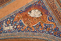 "Detail of solar tiger mosaic, Sher-Dor Madrasah, 1619-36, Samarkand, Uzbekistan, pictured on July 15, 2010. The Sher-Dor Madrasah, commissioned by Yalangtush Bakhodur as part of the Registan ensemble, and designed by Abdujabor, takes its name, ""Having Tigers"", from the double mosaic (restored in the 20th century) on the tympans of the portal arch showing suns and tigers attacking deer. Samarkand, a city on the Silk Road, founded as Afrosiab in the 7th century BC, is a meeting point for the world's cultures. Its most important development was in the Timurid period, 14th to 15th centuries. Picture by Manuel Cohen."