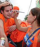 21 June 2006: A Holland fan gets his face painted by another fan. The Netherlands played Argentina at Commerzbank Arena in Frankfurt, Germany in match 37, a Group C first round game, of the 2006 FIFA World Cup.