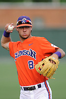 Third baseman Weston Wilson (8) of the Clemson Tigers warms up before a game against the Furman Paladins on Tuesday, May 12, 2015, at Fluor Field at the West End in Greenville, South Carolina. Clemson won, 23-15. (Tom Priddy/Four Seam Images)