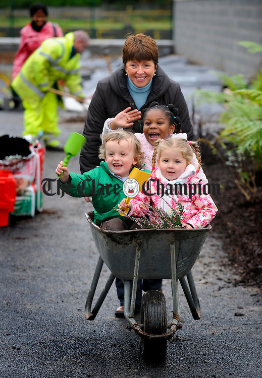 Maureen Keane gives lift in the barrow to Michael Hennigan, Amy Matthews and Stephanie Akujobi  at the Clare Family Resource Centre's new creche at Watery Road Ennis. Photograph by John Kelly.