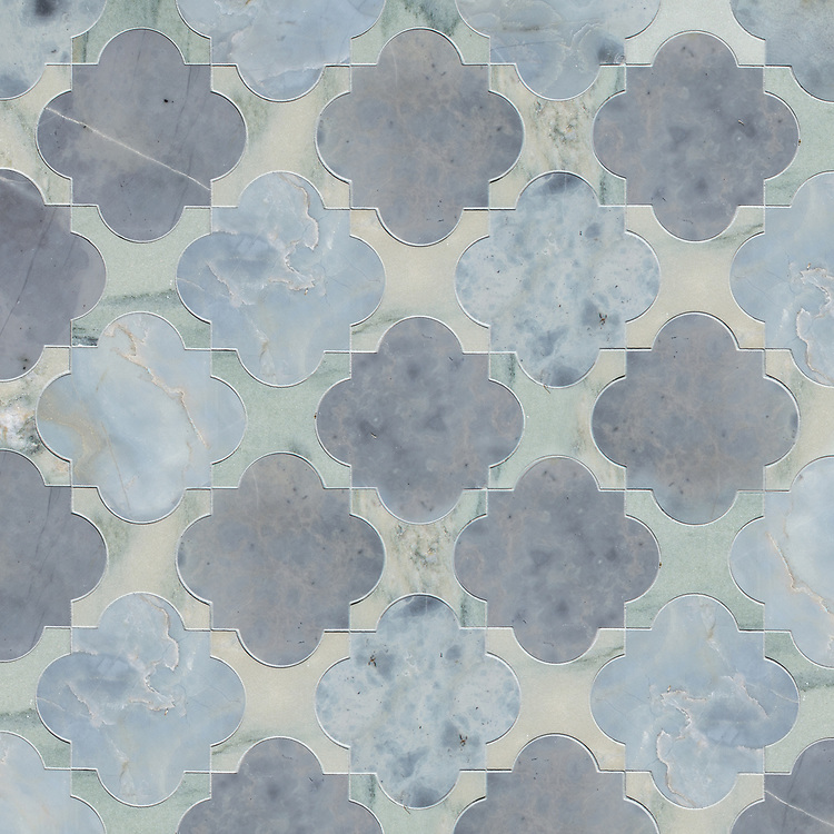 Mallorca, a waterjet stone mosaic, shown in honed Pacifica and Kay's Green, is part of the Miraflores Collection by Paul Schatz for New Ravenna.