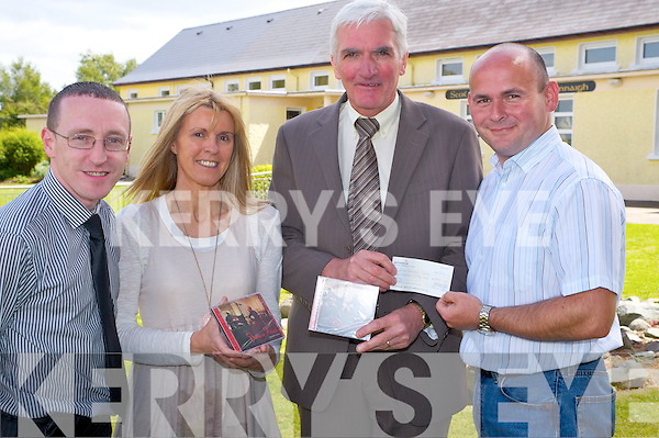 "Mike O'Meara and Mike Coffey, The Two Mikes, pictured as they presented a cheque for EUR550 to  Bertie O'Connor, principal and Moira Cronin, Cullina National School, from the proceeds of the launch night of their new cd ""Between Friends"" held in Kate Kearneys Cottage Beaufort recently. The duo also made a similar presentation to the Palliative Care Unit at Kerry General Hospital."