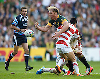 Schalk Burger of South Africa loses the ball after being double-tackled by Luke Thompson and Fumiaki Tanaka of Japan. Rugby World Cup Pool B match between South Africa and Japan on September 19, 2015 at the Brighton Community Stadium in Brighton, England. Photo by: Patrick Khachfe / Stewart Communications