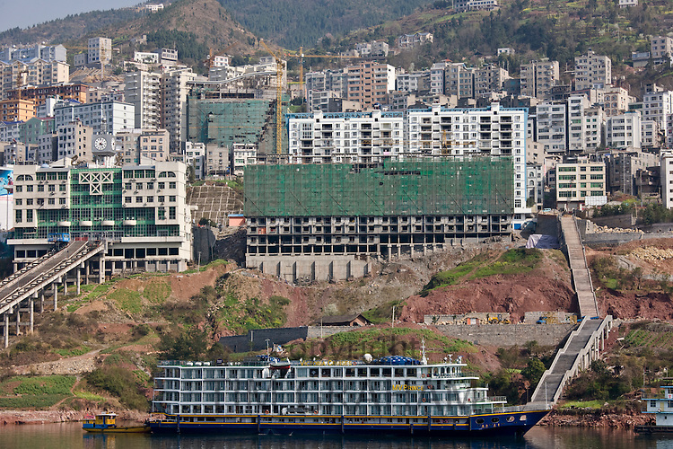 Victoria Line cruise ship by new town built to re-home communities as part of Three Gorges dam project, China