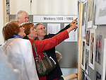 People enjoying the gallery of old photographs at the Slane Mill reunion for former workers. Photo:Colin Bell/pressphotos.ie