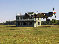 BNPS.co.uk (01202 558833)<br /> Pic: MilitaryAviationMuseum/BNPS<br /> <br /> Over There, Over There...A Spitfire takes off in front of the restored control tower.<br /> <br /> The rebuilt control tower of RAF Goxhill has now been put back together again at the Military Aviation Muuseum in Virginia USA. <br /> <br /> A historic World War Two airfield control tower which helped protect Britain's skies has been transported 4,000 miles to a museum in the United States.<br /> <br /> The monument at RAF Goxhill in North Lincolnshire was dismantled brick by brick before the materials were shipped across the Atlantic to the Military Aviation Museum in Pungo, Virginia.<br /> <br /> The watchtower has been reassembled to look how it would have seven decades ago and is now open to visitors.<br /> <br /> Goxhill was the first airfield to be allocated to the Americans during the conflict, with General D. Eisenhower attending the handover ceremony in August 1942.<br /> <br /> The three year project to relocate the structure, which has cost about £75,000, was overseen by the museum's owner Jerry Yagen. When he heard the watchtower was languishing in a derelict state on the site of the former British airfield, he decided to save it to 'preserve its legacy'.