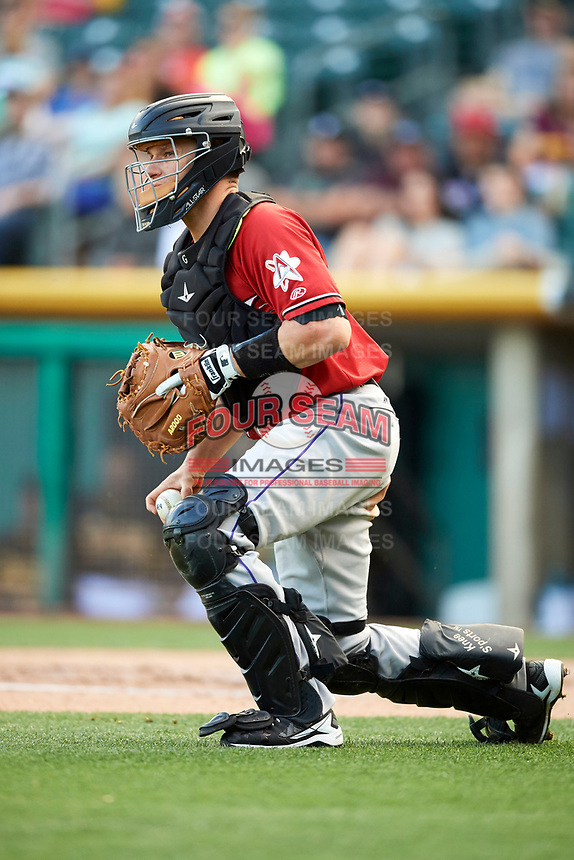 Dustin Garneau (4) of the Albuquerque Isotopes on defense against the Salt Lake Bees in Pacific Coast League action at Smith's Ballpark on June 10, 2017 in Salt Lake City, Utah. The Isotopes defeated the Bees 4-2. (Stephen Smith/Four Seam Images)