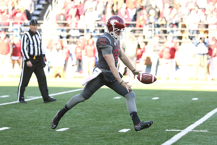 Zach Charme, Washington State University punter, does his thing during the Cougars Pac-12 conference football game against the Arizona State Sun Devils at Martin Stadium in Pullman, Washington, on November 7, 2015.  The Cougs fell behind early but came storming back to cruise by ASU, 38-24..