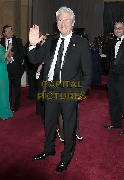 Richard Gere.85th Annual Academy Awards held at the Dolby Theatre at Hollywood & Highland Center, Hollywood, California, USA..February 24th, 2013.oscars full length white shirt black suit tie glasses hand in pocket arm palm waving .CAP/ADM/RE.©Russ Elliot/AdMedia/Capital Pictures.