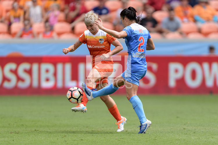 Houston, TX - Saturday April 15, 2017: Janine van Wyk and Jennifer Hoy battle for control of the ball during a regular season National Women's Soccer League (NWSL) match won by the Houston Dash 2-0 over the Chicago Red Stars at BBVA Compass Stadium.