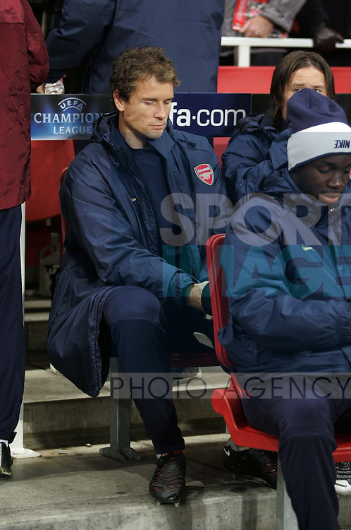 Arsenal's Jens Lehmann looks on dejected from the bench