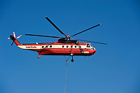 Water dropping fire fighting Helicopter flies through air