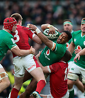 8th February 2020; Aviva Stadium, Dublin, Leinster, Ireland; International Six Nations Rugby, Ireland versus Wales; Bundee Aki (Ireland) attempts to drive through the tackles of Nick Tompkins (Wales) and Hadleigh Parkes (Wales)