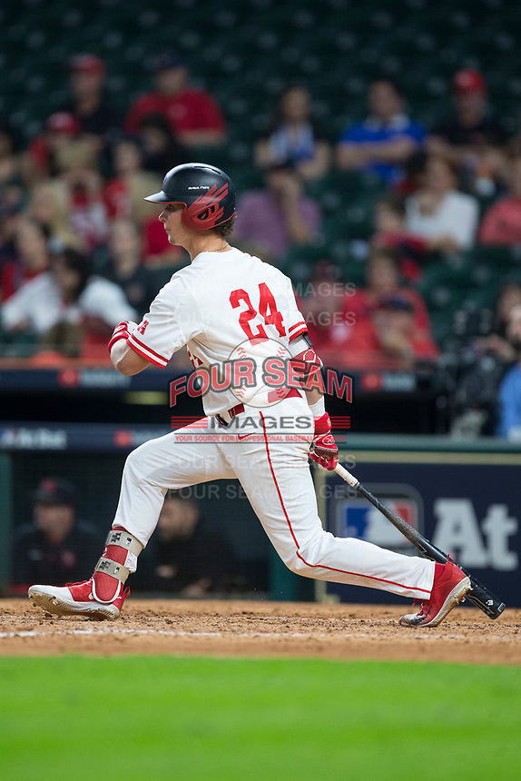 Lael Lockhart Jr. (24) of the Houston Cougars follows through on his swing against the Kentucky Wildcats in game two of the 2018 Shriners Hospitals for Children College Classic at Minute Maid Park on March 2, 2018 in Houston, Texas.  The Wildcats defeated the Cougars 14-2 in 7 innings.   (Brian Westerholt/Four Seam Images)