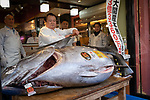 President of sushi restaurant chain Sushi-Zanmai, Kiyoshi Kimura (C), displays a 278kg bluefin tuna at his main restaurant near Tokyo's Tsukiji fish market on January 5, 2018. A record $3.1 million was paid for a giant tuna on January 5 at Tokyo's new fish market called Toyosu, which replaced the world-famous Tsukiji late last year, held its first pre-dawn New Year's auction. January 05, 2019 (Photo by Nicolas Datiche/AFLO) (JAPAN)