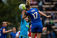 Seattle, WA - Thursday, May 26, 2016: Seattle Reign FC midfielder Beverly Yanez (17) heads the ball under pressure from Arsenal Ladies FC goalkeeper Emma Byrne (1). The Seattle Reign FC of the National Women's Soccer League (NWSL) and the Arsenal Ladies FC of the Women's Super League (FA WSL) played to a 1-1 tie during an international friendly at Memorial Stadium.