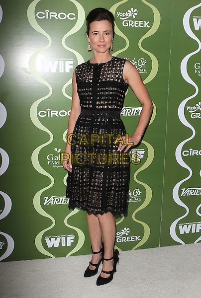 Linda Cardellini<br /> Variety &amp; Women In Film Pre-Emmy Event presented by Yoplait Greek held at Scarpetta, Beverly Hills, California, USA, <br /> 20th September 2013.<br /> full length black dress sleeveless hand on hip<br /> CAP/ADM/KB<br /> &copy;Kevan Brooks/AdMedia/Capital Pictures