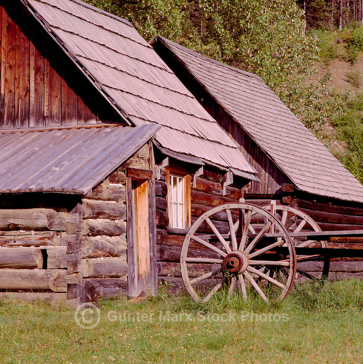 Barkerville, a Restored Historic Gold Rush Town in the Cariboo Region, BC, British Columbia, Canada - Old Log House and Wagon