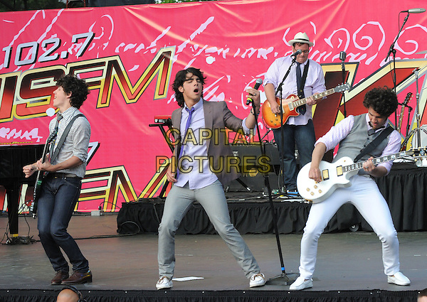 THE JONAS BROTHERS .live at The KIIS Fm Wango Tango 2008 held at The Verizon Wireless Ampitheatre in Irvine, California, USA, May 10th 2008..music concert gig on stage full length guitar tie band .CAP/EAS.©Eastman/Capital Pictures