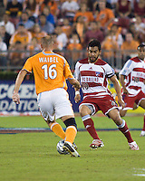 FC Dallas forward Carlos Ruiz (20) attempts to dribble around Houston Dynamo defender Craig Waibel (16).  Houston Dynamo defeated FC Dallas 4-1 at Robertson Stadium in Houston, TX on November 2, 2007.  Houston Dynamo won the Western Conference semifinal series with an aggregate score of 4-2.