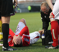Jonathon Brown gets treatment from the physio in the St Mirren v Brechin City William Hill Scottish Cup Round 4 match played at St Mirren Park, Paisley on 1.12.12.