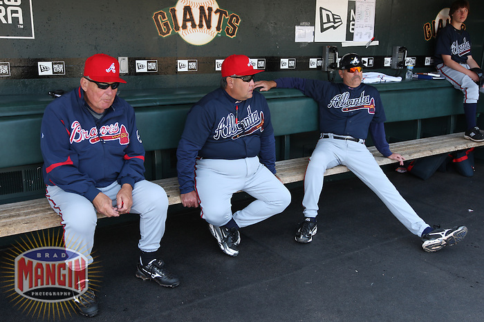 SAN FRANCISCO - MAY 25:  Manager Bobby Cox #6 (left), coach Chino Cadahia #52 (middle) and coach Brian Snitker #43 (right) of the Atlanta Braves get ready in the dugout before the game against the San Francisco Giants at AT&T Park on May 25, 2009 in San Francisco, California. Photo by Brad Mangin