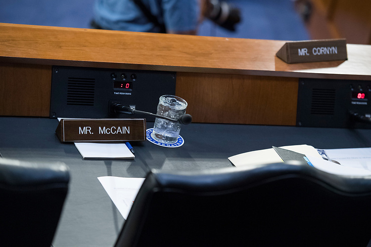 "UNITED STATES - AUGUST 01: The name plate of Sen. McCain, R-Ariz., is seen in his absence during a Senate (Select) Intelligence Committee hearing in Hart Building titled ""Foreign Influence on Social Media Platforms: Perspectives from Third-Party Social Media Experts,"" on August 1, 2018. McCain has been absent from the Senate for several months while battling cancer. (Photo By Tom Williams/CQ Roll Call)"