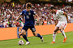 Osako Yuya of Japan (R) fights for the ball with Milad Mohammadikeshmarzi of Iran (R) during the AFC Asian Cup UAE 2019 Semi Finals match between I.R. Iran (IRN) and Japan (JPN) at Hazza Bin Zayed Stadium  on 28 January 2019 in Al Alin, United Arab Emirates. Photo by Marcio Rodrigo Machado / Power Sport Images